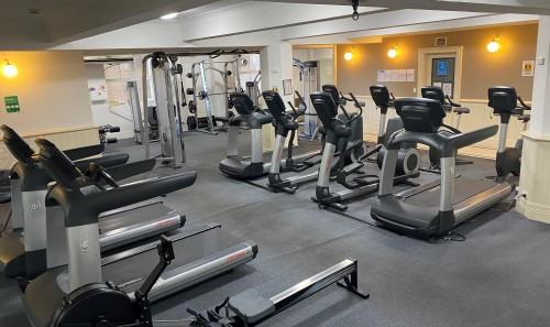 Floor filled with gym equipment